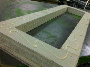 gluing the layers - custom art stretchers for Otis Jones